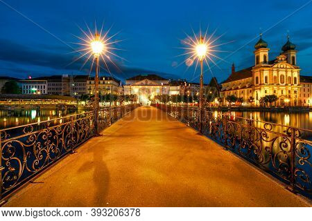 Night In Lucerne City On Lake Lucerne In Switzerland. Jesuitenkirche Church Of St. Francis Xavier Re
