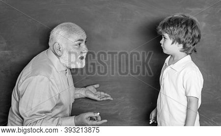 Daddy And Son Together. Grandfather Talking To Grandson. Old And Young. Daddy And His Little Son. A