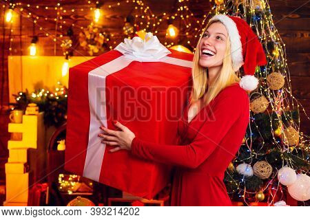 Woman With Christmas Mood. Young Woman In Elegant Red Dress Over Christmas Interior Background. Luxu