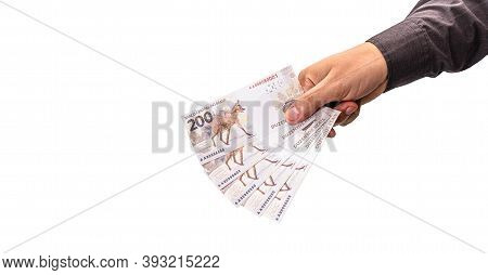 Hand Holding Money, Banknotes Of Two Hundred Reais From Brazil, Concept Of Thirteenth, Salary Bonus