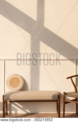 Late afternoon light on a beige wall