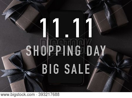 11:11 Sale Shopping Concept, Top View Of Gift Box Wrapped Black Paper And Black Bow Ribbon Present A