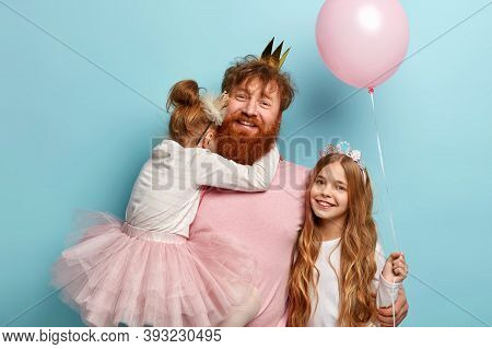 Children, Holiday Concept. Cheerful Dad With Ginger Beard Tries To Amuse Daughters On Party, Carries