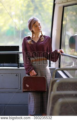 Young Nice Freckled Girl In Retro Style Clothes Standing In A Wagon Of A Driving Tramway. Transporta