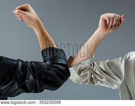 Two People Bump Elbows To Avoid Coronavirus. Coronavirus Epidemic. Closeup Elbow Bump. Elbows Bump.