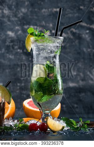 Mojito Cocktail With Lime And Mint In Highball Glass On A Grey Background, Close-up View Classic Moj