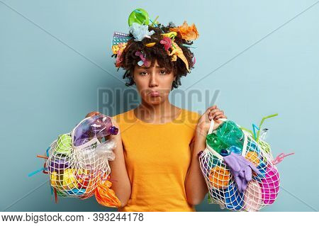 Upset Dejected African American Woman With Miserable Expression, Feels Sad After Cleaning Earth, Car