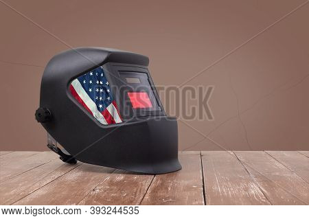 Industrial Tool - Usa Flag Mask Welding Machine On A Wooden And Brawn Wall Background