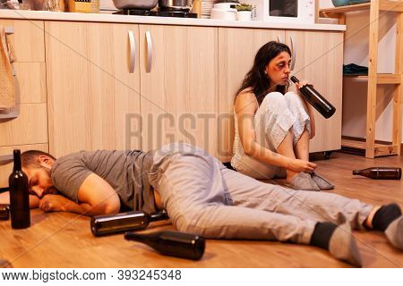 Traumatised Beaten Wife Drinking Wine Because Of Violent Husband While He Is Sleeping On The Floor B