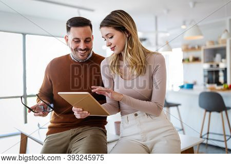 Graphic Designers Working In Office With Laptop. Team Discussing Ideas In Advertising Agency.