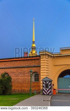 Golden Spire Of Saints Peter And Paul Cathedral Church Over Brick Wall Of Peter And Paul Fortress Ci