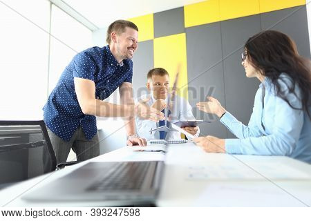 Business Partners Sit At Table And Discuss Workflow. Small And Medium Business Development Concept