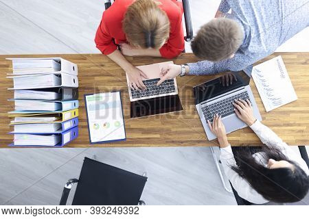 Business People Sit At Their Desk And Discuss Development Strategy. Small And Medium Business Develo