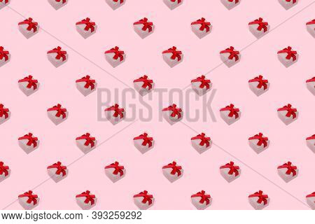 Minimal Composition Pattern Background Of Christmas Gift Box On Pink Background. New Year Concept.
