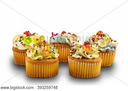 Group Of Vanilla Cupcake With Vanilla Butter Cream Frosting Decorated With Multicolored Rainbow Spri