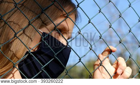 Sad Child Wears Protective Mask Due Coronavirus Pandemic, Sick Unhappy Girl, Depressed Kid Not Playi
