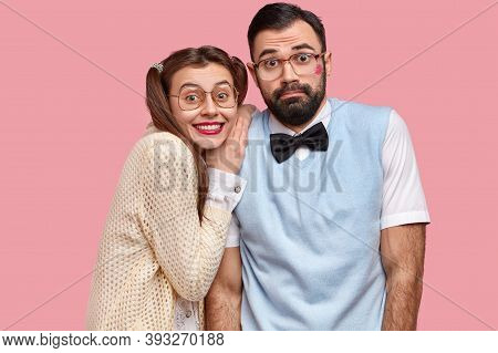 Portrait Of Two Clumsy Female And Male Wonks Stand Closely, Wear Spectacles, Pose For Making Common