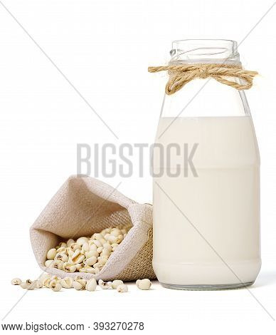 Glass Bottle Of Milk With Seed Millet In Hemp Fabric Bag Isolated On White Background. Homemade Seed