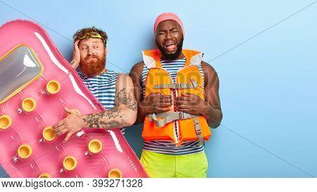 Depressed Balck Man Cries From Despair, Feels Bored At Beach, Wears Swimcap And Lifekacket, Being Ba