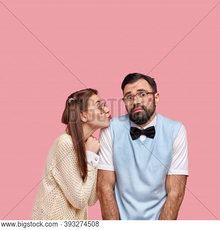 Shot Of Attractive Woman In Old Style Clothes, Gives Kiss To Clumsy Boyfriend Expresses Love And Car