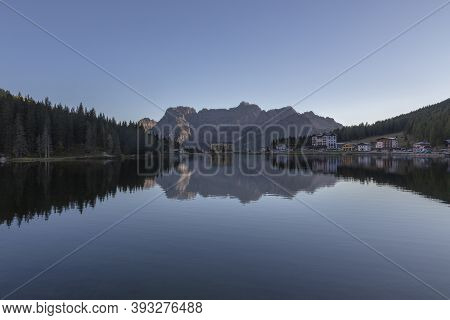 Lake Misurina Dolomiti Italia. The House And The Mountains Are Reflected In The Lake.