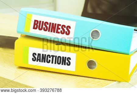 Two Office Folders With Text Business Sanctions