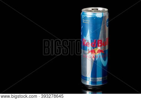 London, United Kingdom, 14th October 2020:- A Can Of Redbull Sugar Free Energy Drink Isolated On A B