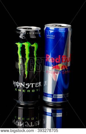 London, United Kingdom, 14th October 2020:- Cans Of Monster And Redbull Energy Drinks Isolated On A