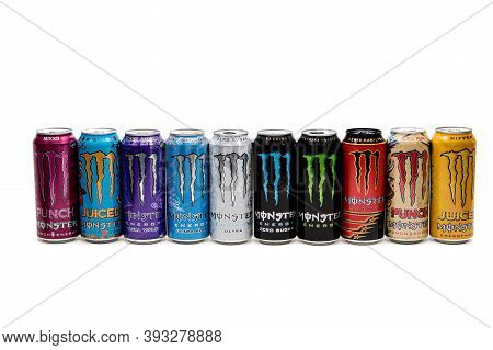 London, United Kingdom, 14th October 2020:- A Selection Of Cans Of Monster Energy Drinks Isolated On