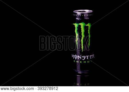 London, United Kingdom, 14th October 2020:- A Can Of Monster Energy Drink Isolated On A Black Backgr