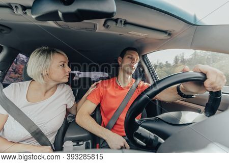 Wife Wakes Up Tired Husband, Falling Asleep At Wheel Of Car. Dangerous Sleep While Driving. Accident