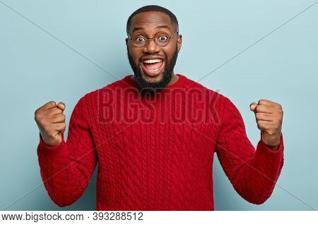 Good News, Success And Happiness Concept. Ecstatic Overjoyed Black Plump Man With Thick Bristle, Cle