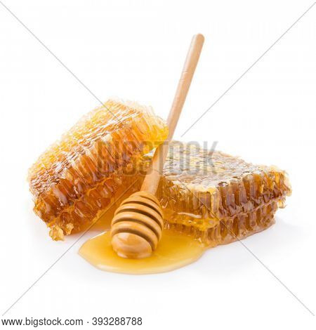 Honeycomb with honey spoon isolated on white background
