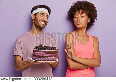 Will Powered Dark Skinned Female Refuses To Consume Delicious Cake On Plate, Makes Refusal Gesture,