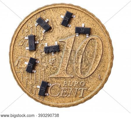 Surface Mount Transistors On 10 Euro Cent Coin Isolated On White Background.