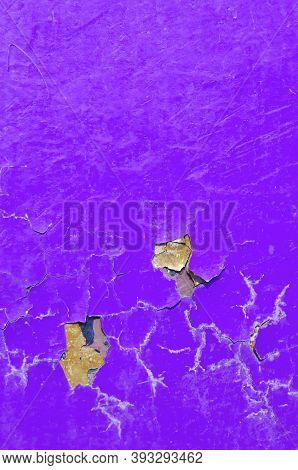 Texture background of peeling paint - purple peeling paint on the texture surface, close up of peeling paint texture on the texture background. Grunge texture surface with purple peeling paint