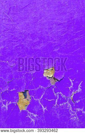 Texture background of peeling paint - purple peeling paint on the texture surface, close up of peeling paint texture on the texture background. Grunge texture surface with purple peeling paint