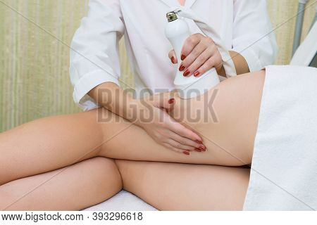 Anti-cellulite Massage On The Lateral Side Of The Thigh. Cavitation In A Beauty Salon On The Thighs