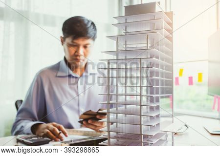 Professional Architect Working Estimate Cost For Condominium Project In Office. Architect Concept. S