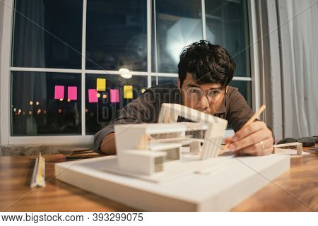 Close Up Model House Modern Style, Asian Man Architect Making Architecture Model Of House. Man Archi
