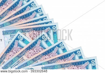 50 Sri Lankan Rupees Bills Lies Isolated On White Background With Copy Space Stacked In Fan Close Up