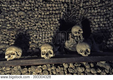 Kutna Hora, Czech Republic, May 14, 2019: Human Bones And Skulls. Row Of Skulls. Skulls Collection.