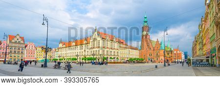 Wroclaw, Poland, May 7, 2019: Old Town Hall And New City Hall Building, Row Of Colorful Traditional