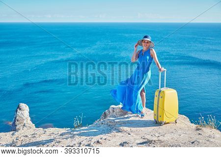 Happy Woman Posing On Ocean Background. Lady Ready For Summer Holiday. Vacation Abroad And Travellin