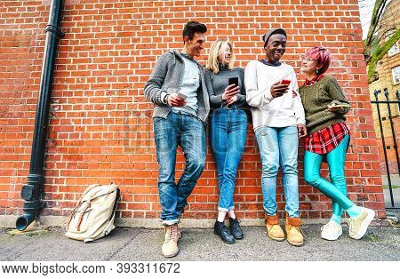 Multicultural Hipster Friends Sharing Content On Smartphone At Urban Area In Shoreditch London - Mil