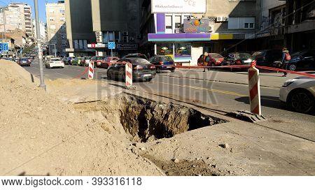 Belgrade, Serbia - January 24, 2020. A Dug Hole In The Street Of Balkans In Belgrade. Men At Work. D