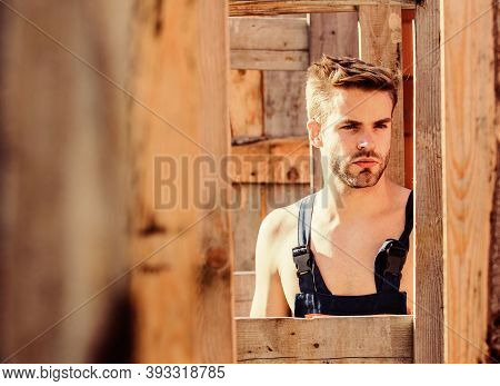Handsome Builder At Construction Site. Guy Works At Construction. Planning Construction. Man Builder