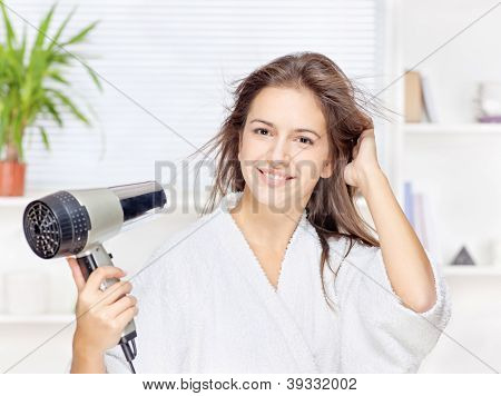 Woman Drying Hair At Home