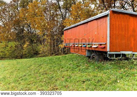 Mobile Apiary Of Different Colors Inczech Republic. Hives With Bees In A Mobile Apiary. ?olored Beeh