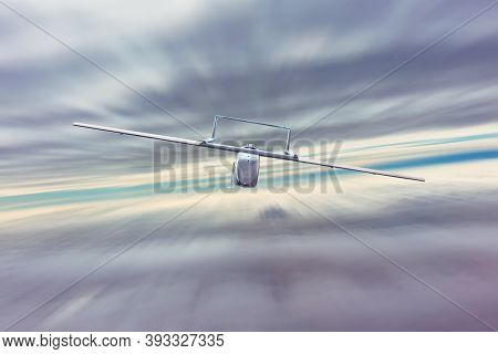 Unmanned Military Drone Uav Flies At High Speed In Dense Clouds, Returning To The Military Base Of D